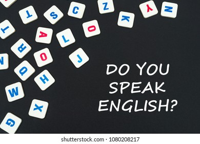english school concept, text do you speak english, colored square english letters scattered on blackboard