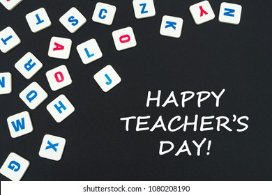 english school concept, text happy teacher's day, colored square english letters scattered on blackboard