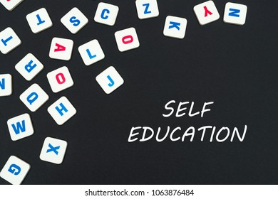 english school concept, text self education, colored square english letters scattered on blackboard