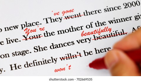 English sentences with red pen for proofreading