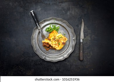 English shepherds pie as top-view on a pewter plate with copy space