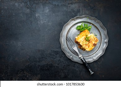 English shepherds pie as top-view on a pewter plate with copy space left