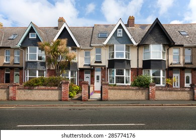 English street of terraced houses, without parked cars.
