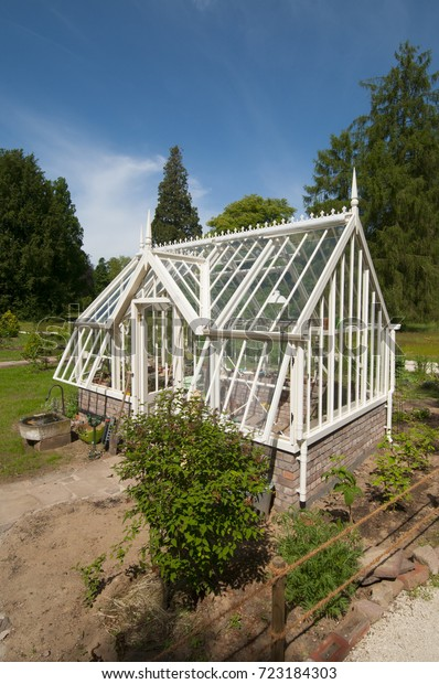 Incredible English Style Greenhouse Stock Photo Edit Now 723184303 Home Interior And Landscaping Ponolsignezvosmurscom