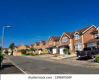 English suburbs; East Sussex, England, May 2019 view of typical English suburban housing