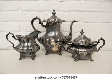 english tea time in retro style. antique silver tea set for rich people, vintage shop or restaurant