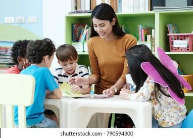 English teacher teach kid in classroom, Preschool child, children and asian woman in class, Group of diversity kindergarten, education concept