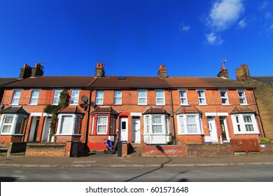 English terraced house with lovely blue sky in spring, England UK.