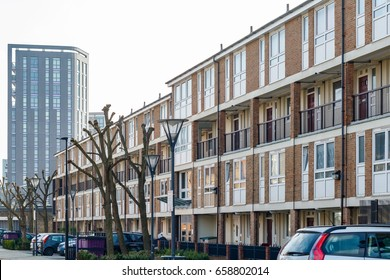 English terraced houses in contrast to modern luxury flats in the background in East London