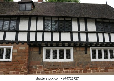 English Tudor School. Outside of an English Tudor School showing sandstone and timber framing.