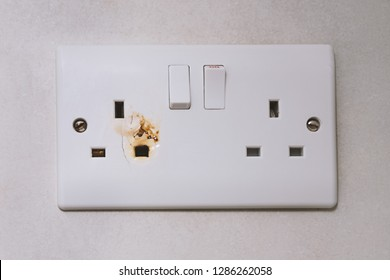 English type G electrical overloaded power plug. Broken power overload switch electric outlet. Outlet, electric plug, electricity. Electric appliance overload, fire danger concept