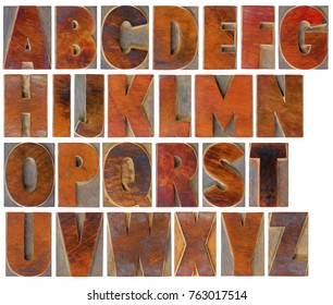 English uppercase alphabet set - a collage of 26 isolated antique wood letterpress printing blocks with a digital painting effect