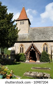 English Village Church with Bell Tower and arched entrance doorway