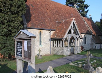 An English Village Church in Winter Sunshine with wooden arched entrance