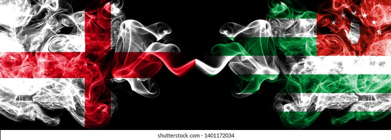English vs Abkhazia, Abkhazian smoky mystic flags placed side by side. Thick colored silky smokes flag of England and Abkhazia, Abkhazian.