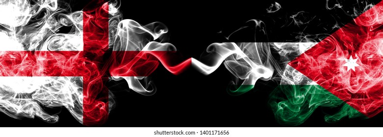 English vs Jordan, Jordanian smoky mystic flags placed side by side. Thick colored silky smokes flag of England and Jordan, Jordanian.