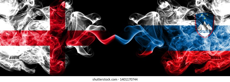 English vs Slovenia, Slovenian smoky mystic flags placed side by side. Thick colored silky smokes flag of England and Slovenia, Slovenian.