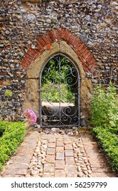An English Walled garden with arched entrance through the Wall