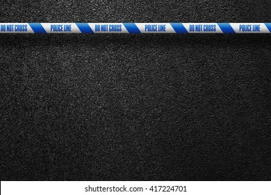 English white-blue police line in the background smooth asphalt road. Do not cross. The texture of the tarmac, top view.