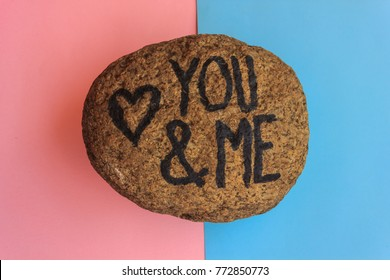 the english  writing you and me with a heart drawn on a stone /the writing you and me with a heart drawn on a stone,indicates the love promise of two lovers