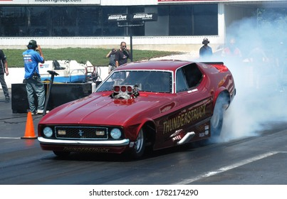 Englishtown, NJ / USA - July 25, 2010: The Thunderstruck Funny Car performs a smoky burnout during a vintage drag racing event in Englishtown, New Jersey.