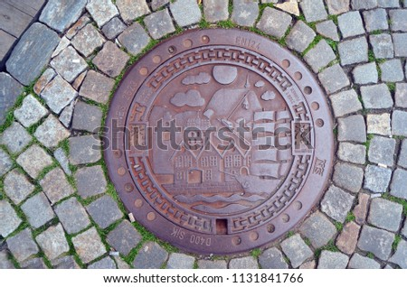 Engraved manhole cover showing port of Bergen, City of Culture, in Norway.June 27,2018. Bergen,Norway