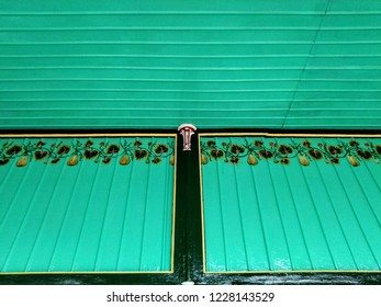 engraved and painted ornaments on fascia board and roof of a corridor in yogyakarta sultanate palace