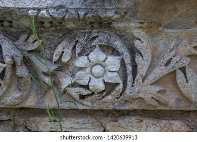 Engraving on stone at Aizonai ancient city.