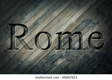 Engraving spelling the city Rome on textured old surface