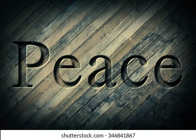 Engraving spelling the word Peace on textured old surface
