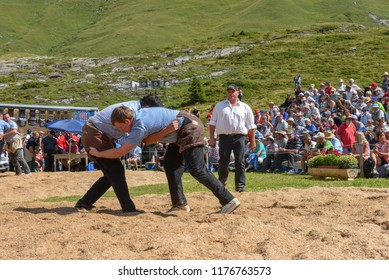 Engstlenalp, Switzerland - 4 August 2018: Two Swiss taking part in a traditional wrestling match (called 'Schwingen') at Engstlenalp on the Swiss alps