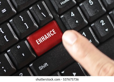 ENHANCE word on red keyboard button