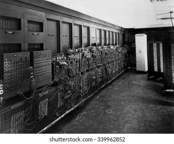 ENIAC computer was the first general-purpose electronic digital computer. 'Electronic Numerical Integrator And Computer' was 150 feet wide with 20 banks of flashing lights. Ca. 1946