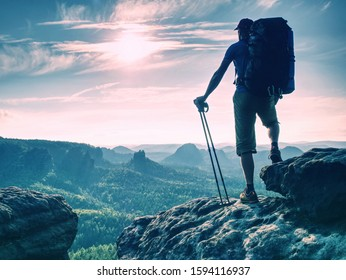 Enjoy the amazing view from top of the world. Hiker take rest for watching the landscape below. Popular nordic walking