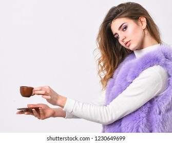 Enjoy aroma and taste hot coffee. Woman fur coat drink coffee. Elite coffee concept. Elite coffee variety concept. Elite drink with caffeine. Lady drink espresso little ceramic cup white background.