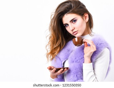 Enjoy aroma and taste hot coffee. Elite drink with caffeine. Elite coffee concept. Woman makeup wear luxurious fur coat drink hot coffee. Pretty lady drink coffee little ceramic cup white background.
