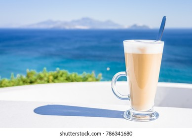 Enjoy a cup of coffee latte cappuccino in the greek morning light at a terrace with beautiful view to the mediterranean sea, Southcoast, Kos, Dodecanese, Greece