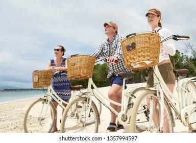 Enjoy each other's company on travel. Front view of young people cycling together while spending carefree time outdoors in holiday.