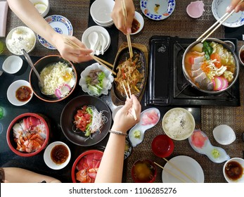 Enjoy eating with friends .Top view of group of people have eating food of Japanese food