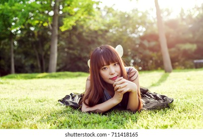 Enjoy the green nature of Asian women, bathed in the sun on the grass