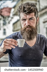 Enjoy hot drink. Hipster drinking fresh brewed coffee. Bearded guy consume caffeine. Espresso arabica only. Coffee break concept. Guy relaxing espresso. Man with beard and mustache and espresso cup.