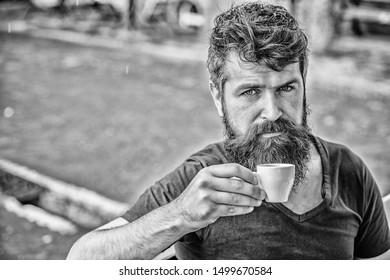 Enjoy hot drink. Hipster drinking fresh brewed coffee. Bearded guy consume caffeine. Espresso arabica only. Guy relaxing espresso. Man with beard and mustache and espresso cup. Coffee break concept.