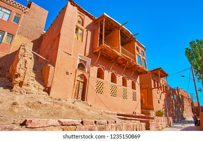 Enjoy the lazy walk along the old street of Abyaneh village, lined with traditional red-ochre edifices, Iran.