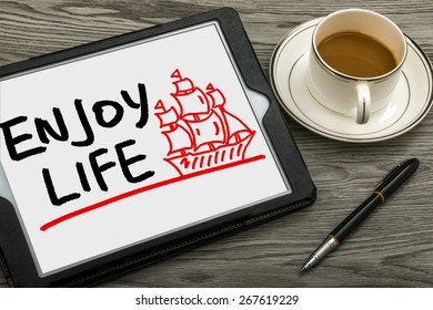 enjoy life concept and sailing boat hand drawing on tablet pc