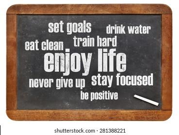 enjoy life - healthy lifestyle word cloud on a vintage blackboard