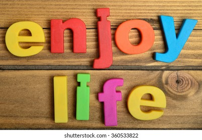 Enjoy life word on wooden table