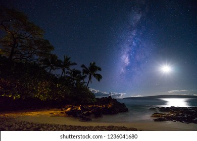 Enjoy the Milky Way and the Moon with lava rocks, palm trees and golden sands in Makena Cove, Hawaii