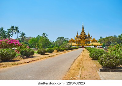 Enjoy the ornamental Kanbawzathadi garden with trimmed bushes, blooming bougainvillea and tall palm trees around medieval golden palace, Bago, Myanmar.