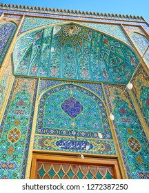 Enjoy the ornate tile patterns on the portal (iwan) of Imam Zadeh Jafar Shrine with floral motives and Islamic calligraphy, Yazd, Iran.