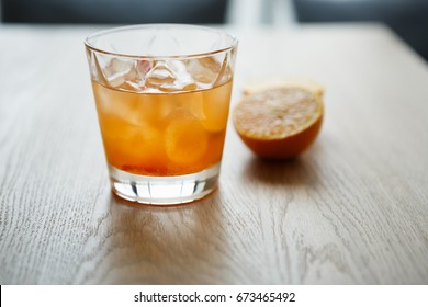 Enjoy refreshing tequila sunrise long drink in the bar.Juicy cocktails for party.Crystal glass with orange juice & booze.Hot drinks for adult people